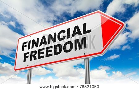 Financial Freedom on Red Road Sign.