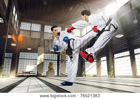Karate fighting woman in the gym