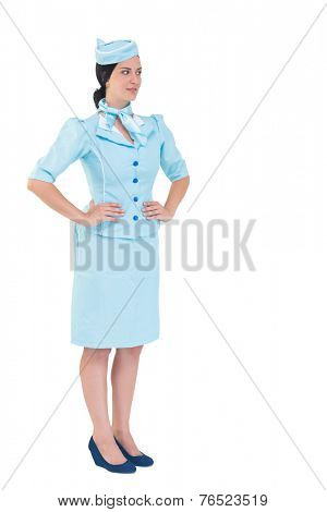 Pretty air hostess with hands on hips on white background