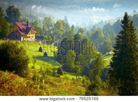 House in the foggy mountains. Carpathian, Ukraine.