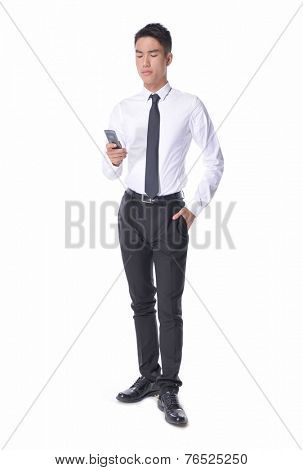 Full body of a young Asian business man using smart phone