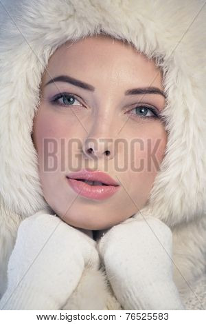 Young Woman Wearing A Fur Cap