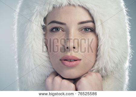 Young Woman Wearing A White Fur Cap
