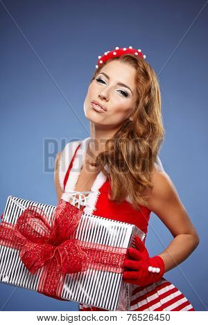 Portrait of beautiful sexy girl wearing santa claus clothes