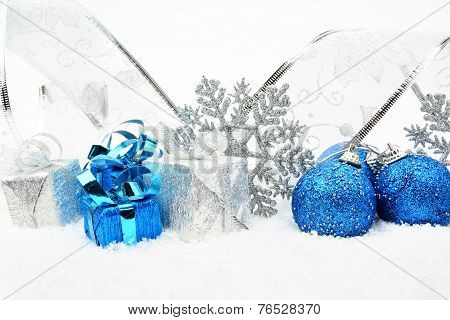 Silver,blue Christmas Baubles,gifts,snowflake With Silver Ribbon On Snow