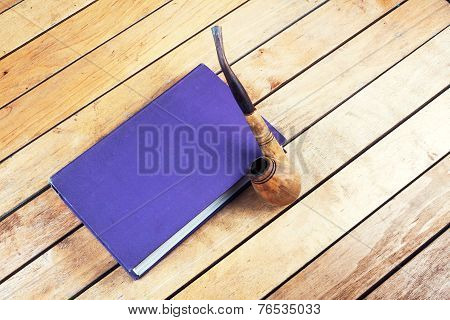 Smoking Pipe And Book