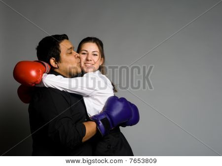 Young Couple With Boxing Gloves Kissing
