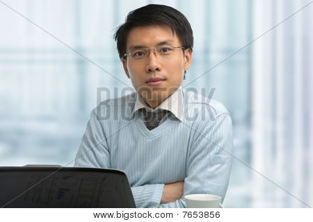 Young Chinese Male Working In Office