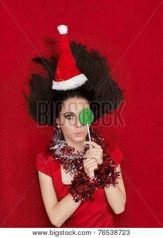 Funny Christmas Girl with Delicious Green Lollipop