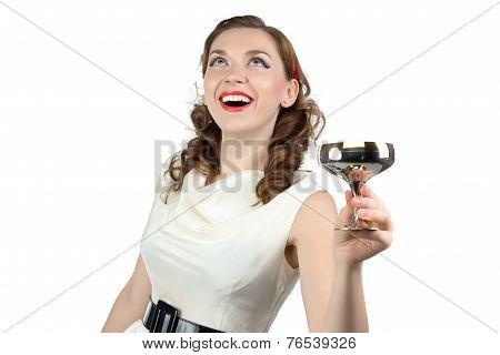 Photo of woman looking up with metal snifter
