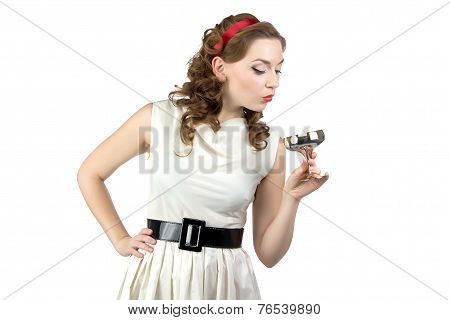 Photo of woman looking at metal snifter