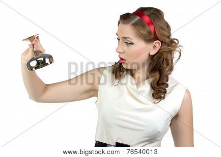 Image of woman looking at metal snifter