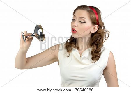 Portrait of woman looking at metal snifter