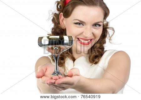 Portrait of smiling woman with metal snifter