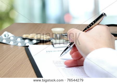 Doctor  In A White Labcoat Writing Out Rx Prescription