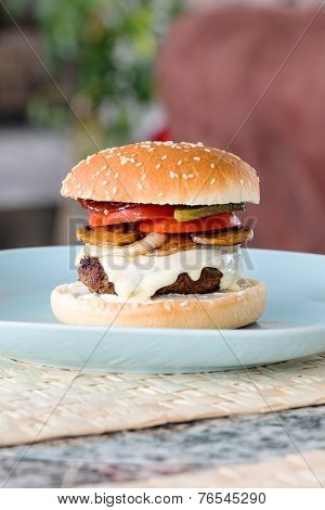 Freshly prepared home made beef cheeseburger with fresh onions, mushrooms, tomatoes and pickles. No lettuce.