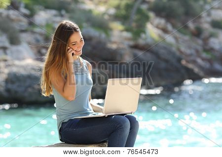 Freelance Woman Working In Vacation On The Phone
