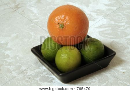 Clementine atop Key Limes