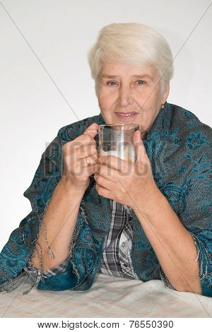 Senior Woman Drinks Coffee