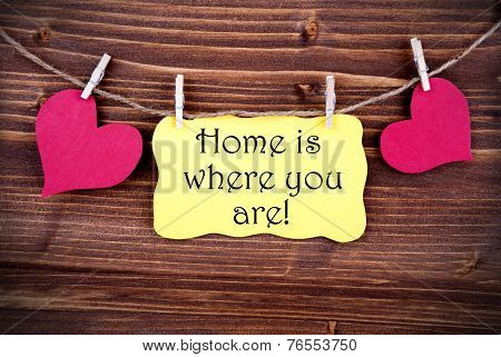 Yellow Lable Saying Home Is Where You Are