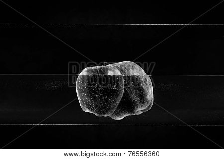 Small apple in see trough water