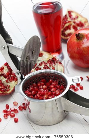 pomegranate fruits, pomegranate juice and juice press