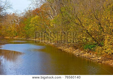 Trees along the canal in autumn foliage.