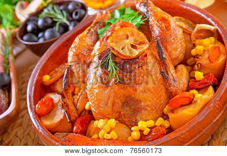 Closeup on delicious baked Thanksgiving turkey baked with vegetables, traditional American autumn holiday, festive dinner at home concept