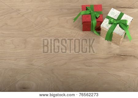 Christmas Gifts In Wood Background