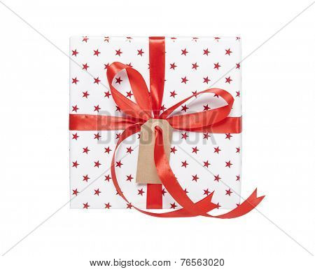 Gift with a ribbon and gift tag isolated on white background