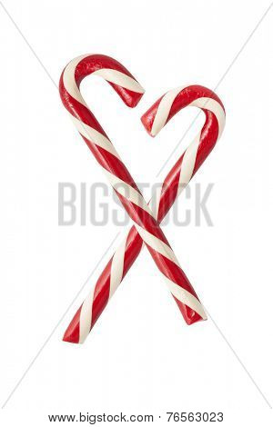 Two christmas candycanes forming a heart shape