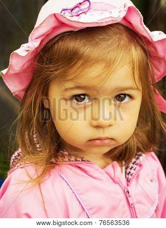 Portrait of cute sad little girl