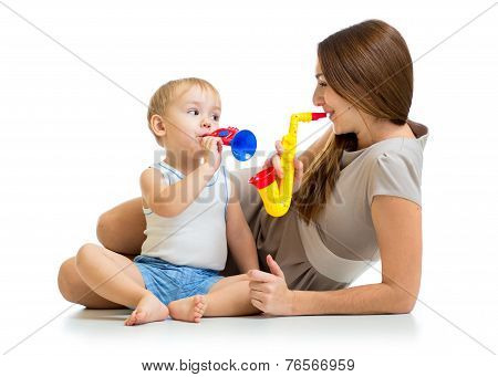 kid and mother play musical toys