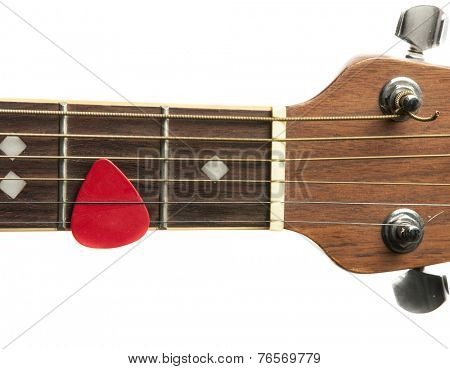 Acoustic Guitar neck and pick with white background