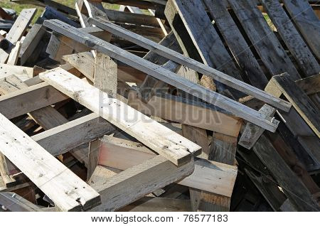 pile of wooden pallets highly flammable in the construction site