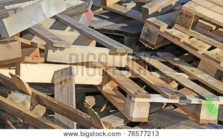 pile of wooden pallets highly flammable in the industrial site