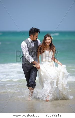 Happiness And Romantic Scene Of Love Just Married Couple Walking And At Beautiful Beach