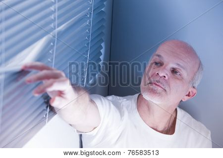 Hidden Man Checking Outside For Thieves
