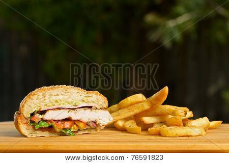 Cutted burger with melted cheese and thick succulent ground chicken patty, lettuce, tomato, onion, s