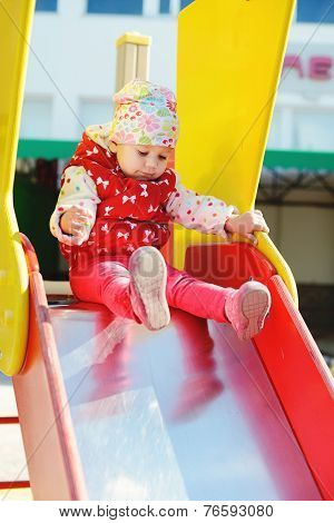 Cute Toddler On Slide