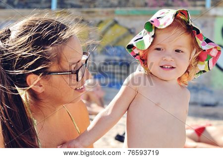 Baby Daughter And Mother On The Beach
