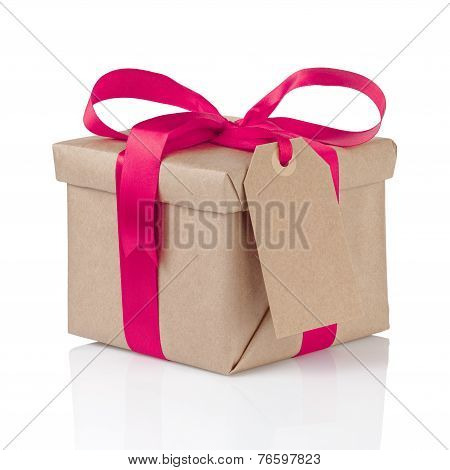 Gift Christmas Box Wrapped With Kraft Paper And Purple Bow