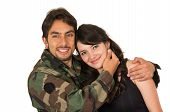 stock photo of reunited  - affectionate returning young military soldier hugging his wife girlfriend isolated on white - JPG