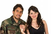 pic of reunited  - young military soldier returns to meet his wife girlfriend holding hands isolated on white - JPG