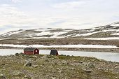 image of shacks  - Red shack in the mountains at Sognefjord Norway - JPG