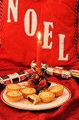 foto of desert christmas  - Mince Pies with a candle and Christmas crackers and Noel background - JPG