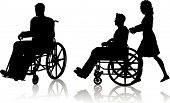 pic of crippled  - Silhouette of a man in a wheelchair and one with a woman pushing him - JPG