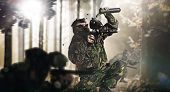picture of paintball  - Paintball team in action rainy forest location - JPG