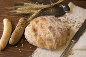 picture of home-made bread  - Home made bread and rolls on a wooden background - JPG
