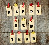 foto of pegging  - Happy new year lettering with clothes - JPG
